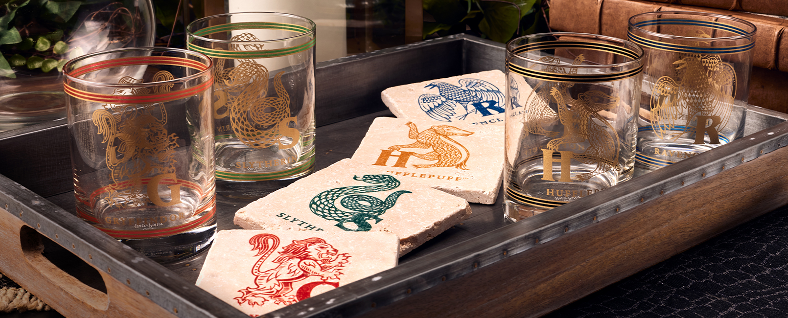 Gryffindor™, Slytherin™, Hufflepuff™ and Ravenclaw™ Glass Tumblers with Travertine Coasters