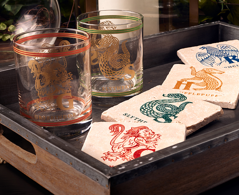Gryffindor™ and Slytherin™ Glass Tumblers with Gryffindor™, Slytherin™, Hufflepuff™ and Ravenclaw™ Travertine Coasters